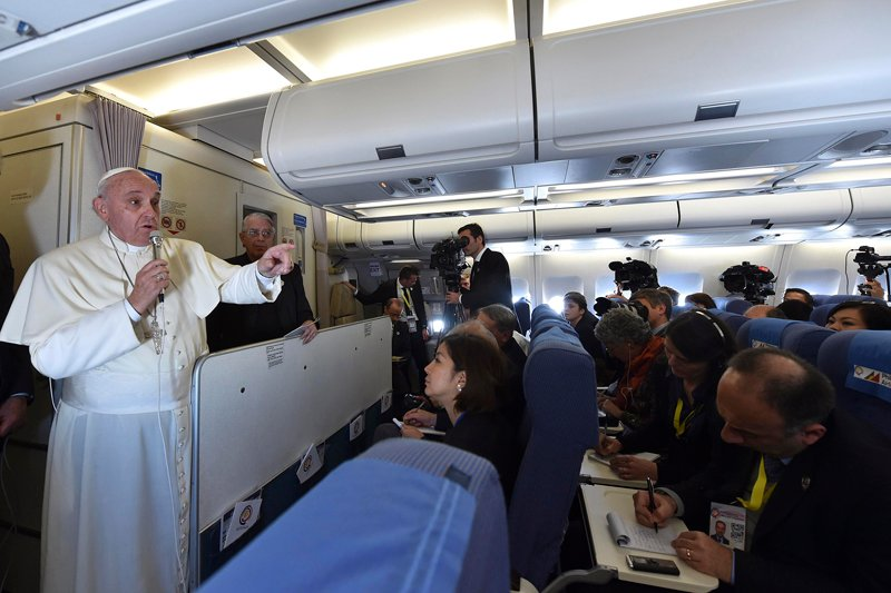 Pope Francis gestures as he speaks with journalists on his flight back from Manila to Rome on Monday (January 19, 2015). Photo courtesy of REUTERS/Giuseppe Cacace/Pool   *Note: This photo may only be used with RNS-POPE-CONTRACEPTION, published on January 20, 2015