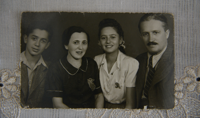 Auschwitz survivor Renee Ganz, 86, from Oradea, Romania, discusses her time at the Nazi concentration camp on the 70th anniversary the allied forces liberation in 1945, from her apartment in Tel Aviv, Israel, on January 21, 2015.  An old photo of Renee's family before the war, left to right, Brother, Nickolai, mother, Bella, Renee, and father, Laslo. Renee's father and brother were murdered in Auschwitz. Her mother survived but died of cancer in 1953. Photo by Debbie  Hill, courtesy of USA Today