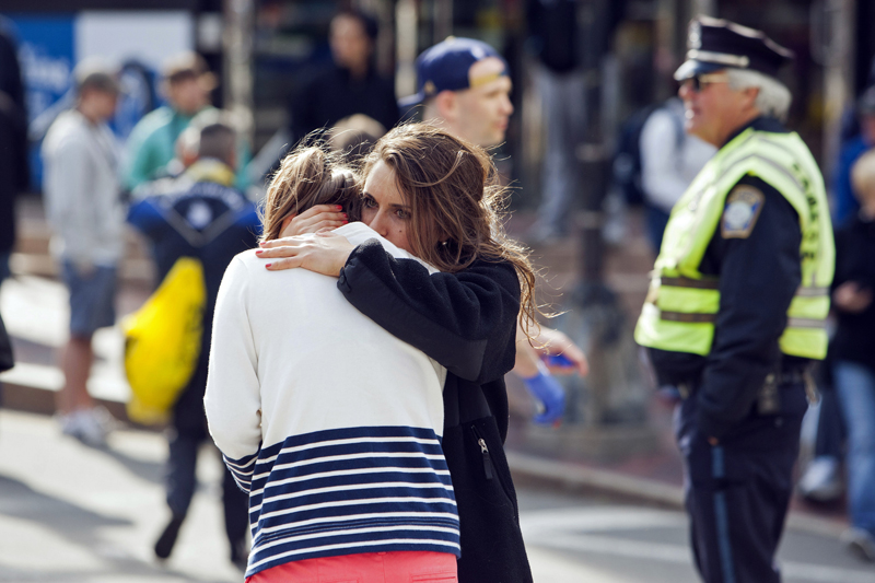 (RNS) A woman comforts another woman after a terrorist attack on the 117th Boston Marathon in Boston, Massachusetts April 15, 2013. For use with RNS-HOOVER-COLUMN, transmitted Jan. 30, 2015. Photo by Dominick Reuter/Reuters.  *Eds: This photo can be used ONLY with RNS-HOOVER-COLUMN.
