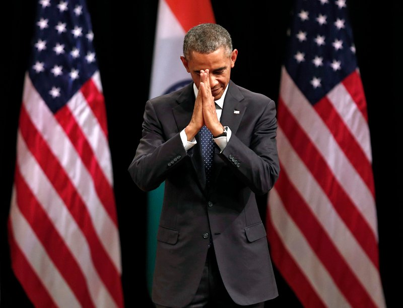 U.S. President Barack Obama folds his hands in a traditional Indian greeting after he addressed a gathering at Siri Fort Auditorium in New Delhi on Tuesday (January 27, 2015). Obama weighed in on one of India's most sensitive topics as he wound up a visit on Tuesday, making a plea for freedom of religion to be upheld in a country where relations between Hindus and minorities have come under strain. Photo courtesy of REUTERS/Ahmad Masood *Note: This photo may only be republished with RNS-OBAMA-RELIGION, originally published on January 27, 2015.