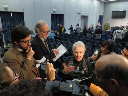 Marie Collins, center, spoke to reporters after a Feb. 7 news conference at the Vatican. Collins, of Ireland, was sexually assaulted by a priest as a girl. She is a member of Pope Francis' Commission for the Protection of Minors.