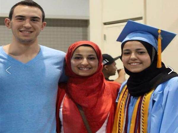 Deah Shaddy Barakat, 23, his wife, Yusor Mohammad Abu-Salha, 21, center, and Abu-Salha's sister, Razan Mohammad Abu-Salha, 19,  far right, of Raleigh, were killed on Tuesday (February 11, 2015) inside their condominium near the University of North Carolina campus in Chapel Hill. Photo courtesy of Omid Safi