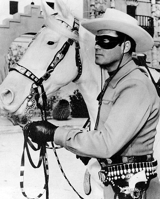 Publicity photo of Clayton Moore as the Lone Ranger and Silver from a personal appearance booking at Pleasure Island (Massachusetts amusement park), Wakefield Massachusetts.