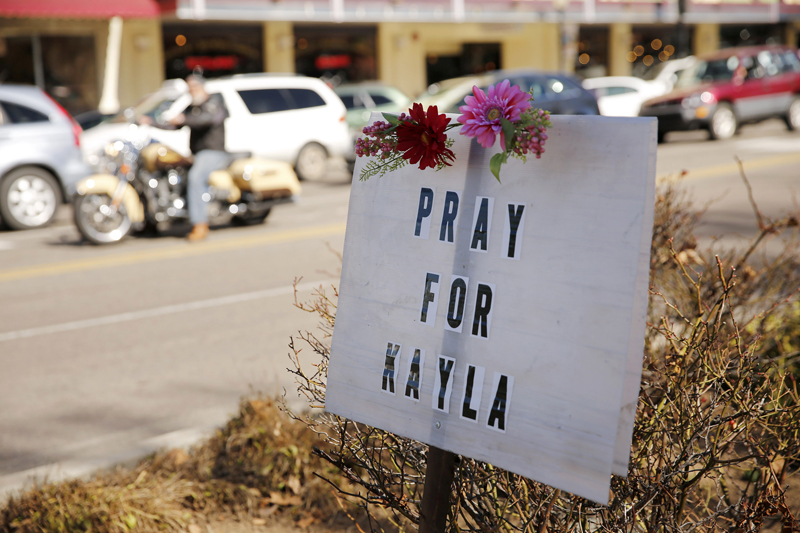 """A sign for Kayla Mueller is displayed along a main street in Prescott on February 10, 2015. President Barack Obama and the family of U.S. aid worker Mueller confirmed on Tuesday that the last-known American hostage held by Islamic State militants had died, with Obama promising to """"find and bring to justice the terrorists who are responsible."""" Photo courtesy of REUTERS/Nancy Wiechec  *Editors: This photo may only be republished with RNS-AID-WORKERS, originally transmitted on February 11, 2015"""