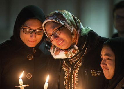 (RNS1-feb16) Students with lit candles attend a vigil on the campus of the University of North Carolina, for Deah Shaddy Barakat, his wife Yusor Mohammad and Yusor's sister Razan Mohammad Abu-Salha who were killed in Chapel Hill, North Carolina February 11, 2015. Photo courtesy of REUTERS/Chris Keane