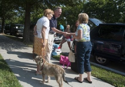 President John Garvey, center, with his wife Jeanne and dog Gus greet the families of new students arriving on campus during freshman move-in day Thursday, August 21, 2014 at The Catholic University of America in Washington, D.C. Photo by Ed Pfueller, courtesy of The Catholic Univeristy of America