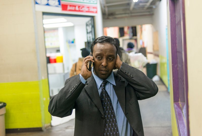 """Mohamed Amin Ahmed, at the 24th Street Mall, a Somali Mall in Minneapolis, Minn. Ahmed is a convenience store manager who has created a series of cartoon shorts called """"Average Mohamed."""" The cartoons are meant to counter the Islamic State's efforts to recruit young Muslims in the United States. Photo by Stephen Maturen, courtesy of USA Today"""