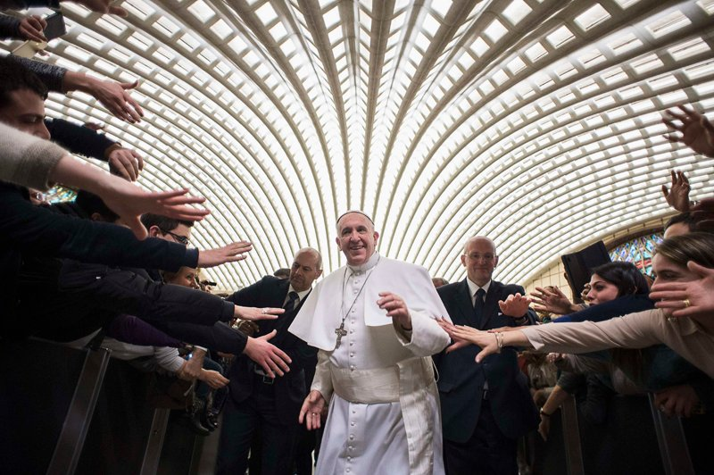 Pope Francis arrives to lead a special audience with faithful from Cassano alpo Jonio diocese at the Vatican on February 21, 2015. Photo courtesy of REUTERS/Osservatore Romano *Editors: This photo is not available for republication.