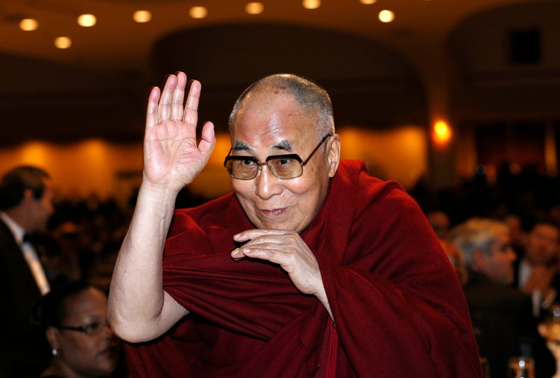 The Dalai Lama waves towards the head table, where U.S. President Barack Obama is seated, during the National Prayer Breakfast in Washington on Thursday (February 5, 2015). Photo courtesy of REUTERS/Kevin Lamarque *Editors: This photo may only be republished with RNS-PRAYER-BREAKFAST, originally transmitted on February 5, 2015.