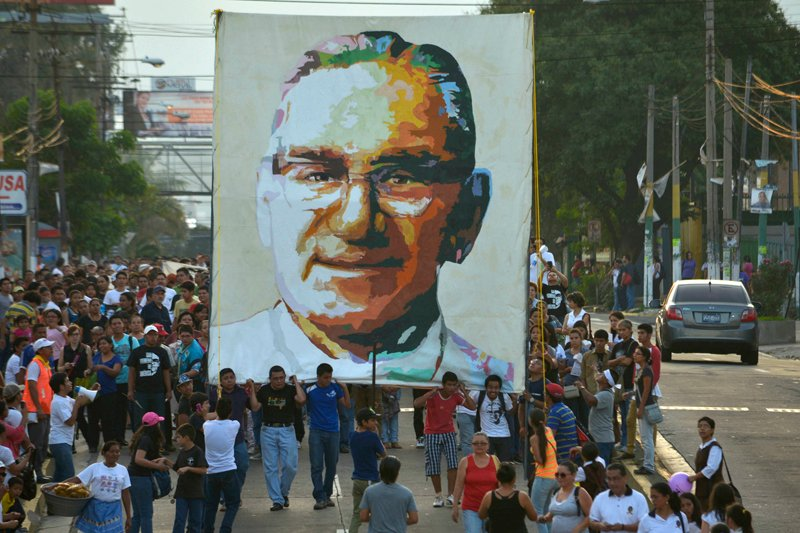 People carry a picture of late Archbishop Oscar Arnulfo Romero during a march ahead of the 34th anniversary of his assassination in San Salvador on March 22, 2014. Photo courtesy of REUTERS/Jessica Orellana *Editors: This photo can only be republished with RNS-ROMERO-POPE, originally transmitted on February 3, 2015.