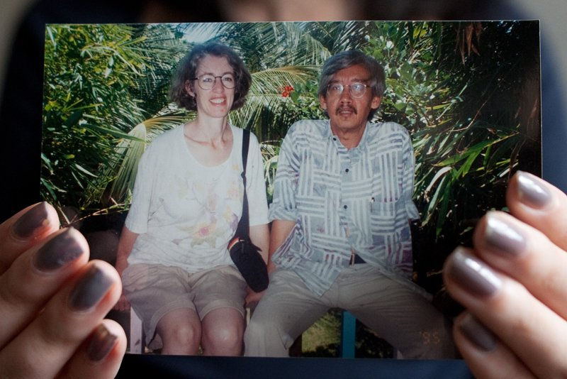 Nadia Bulkin holds a picture of her parents, Jan Hostetler, left, and Farchan Bulkin, taken in Indonesia. Her father passed away and her mother lives in Nebraska. Religion News Service photo by Sait Serkan Gurbuz