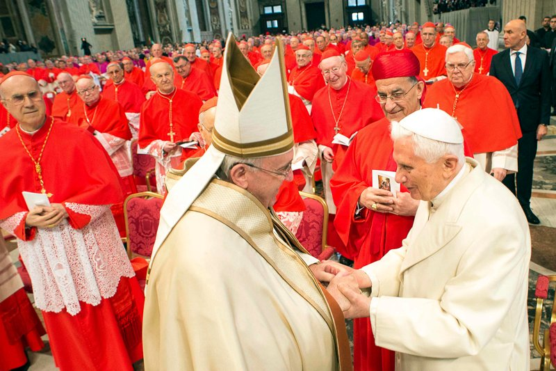 (RNS) Pope Francis, left, greets Emeritus Pope Benedict XVI during a mass to create 20 new cardinals during a ceremony in St. Peter's Basilica at the Vatican February 14, 2015. RNS photo courtesy REUTERS/Osservatore Romano. * NOTE: This photo can only be used with RNS-NEW-CARDINALS, transmitted FEb. 14, 2015.