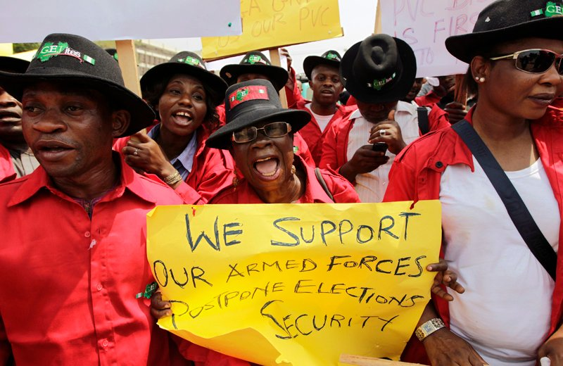 (RNS) Demonstrators gather at the Independent National Electoral Commission Office in Abuja, February 9, 2015. Nigeria's agreement to delay this week's election on the advice of security forces creates a worrying echo for some of the annulment of 1993's democratic vote by a military government.  Photo courtesy REUTERS/Afolabi Sotunde. * NOTE: This photo can only be used with RNS-NIGERIA-BOKO, transmitted Feb. 9, 1975.