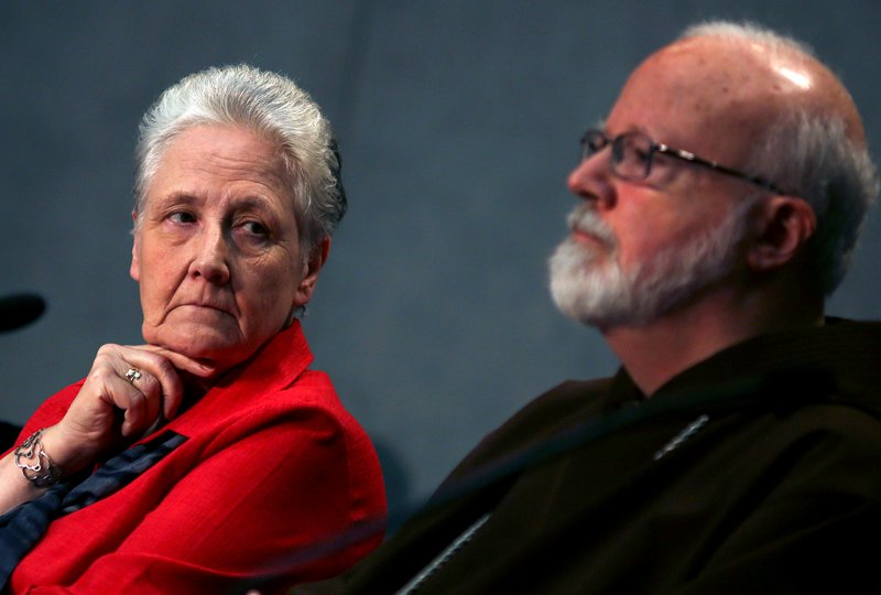 (RNS) Abuse victim Marie Collins, left, member of the Pontifical Commission for the Protection of Minors, looks at Cardinal Sean Patrick O'Malley of Bostonduring their first briefing at the Holy See press office at the Vatican May 3, 2014. For use ONLY with RNS-VATICAN-ABUSE, transmitted Feb. 6, 2015. Photo courtesy REUTERS/Alessandro Bianchi