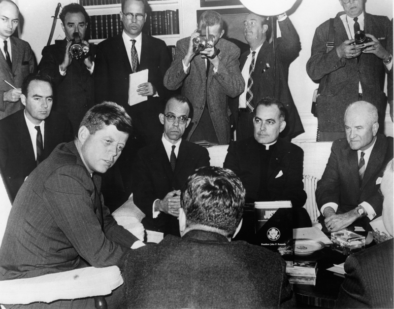 (RNS) President John F. Kennedy meets with the Civil Rights Commission at the White House, including the Rev. Theodore Hesburgh, (seated, second from right), president of the University of Notre Dame, in 1961. RNS file photo.