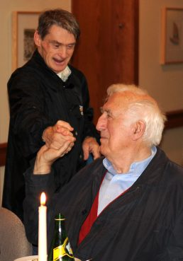 Jean Vanier shaking hands with one of the core members of L'Arche Daybreak, John Smeltzer, in October, 2009.