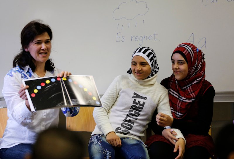 Syrian refugees learn the German language in a school at the 'Friedland' refugee camp in the central German village of Friedland Photo courtesy REUTERS/Ina Fassbender.