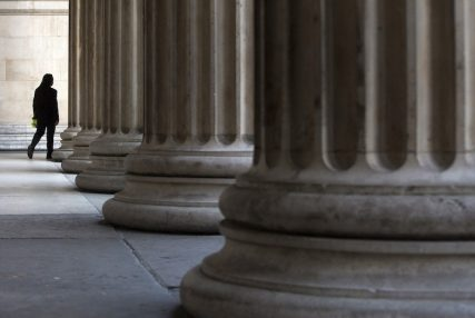 A man walks through columns outside the British Museum in London. Reuters photo Neil Hall.