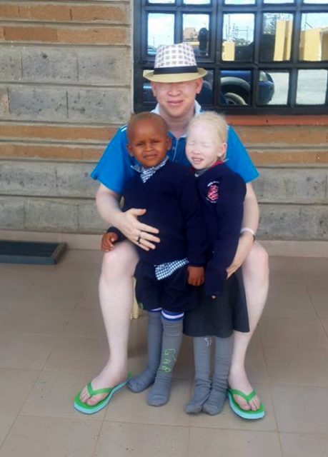 Children of Kenyan member of parliament, Isaac Mwaura, who almost lost their lives to ritual killers in Tanzania. The killers believe that body parts of persons with albinism brings good fortune and wealth. Photo courtesy of Isaac Mwaura, USA Today