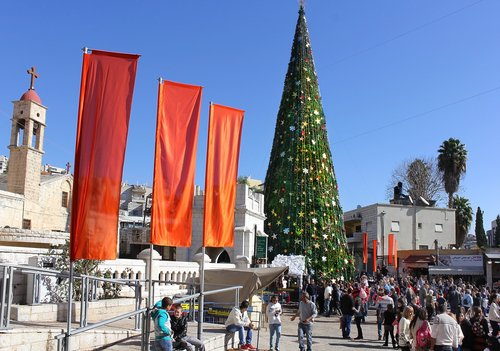 People celebrate Christmas, near the Greek Orthodox Church of the Annunciation in Nazareth, Israel, on December 21, 2013.