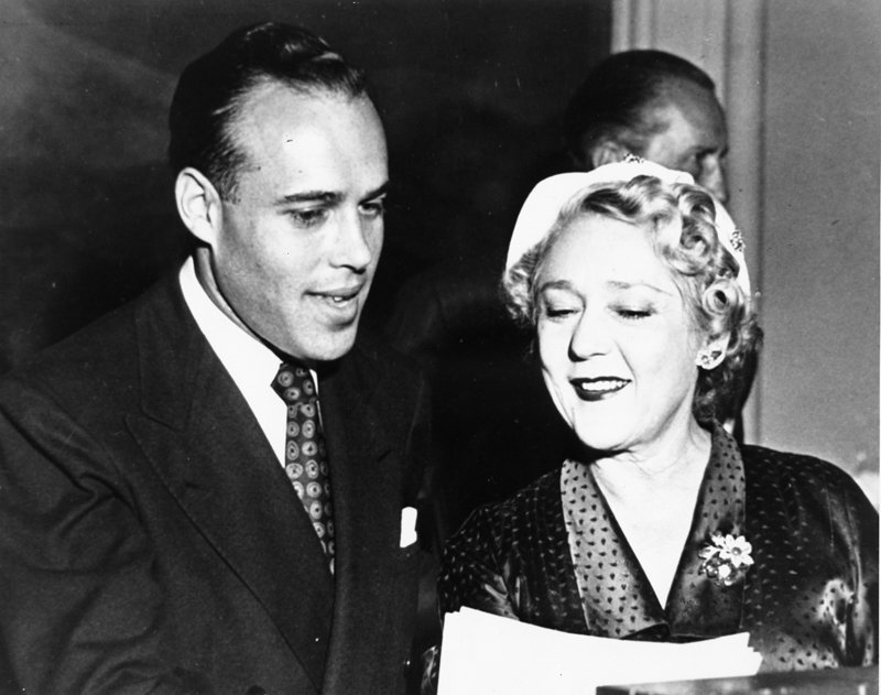Boyd-Pickford 1949: Malcolm Boyd with Mary Pickford at the Hollywood Advertising Club in 1949. Boyd was guest speaker and Pickford was guest of honor. Photo courtesy of Malcolm Boyd archives
