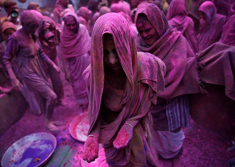 Widows daubed in colors take part in the Holi celebrations organized by non-governmental organization Sulabh International at a widows' ashram at Vrindavan, in the northern Indian state of Uttar Pradesh on March 3, 2015. Photo courtesy of REUTERS/Ahmad Masood