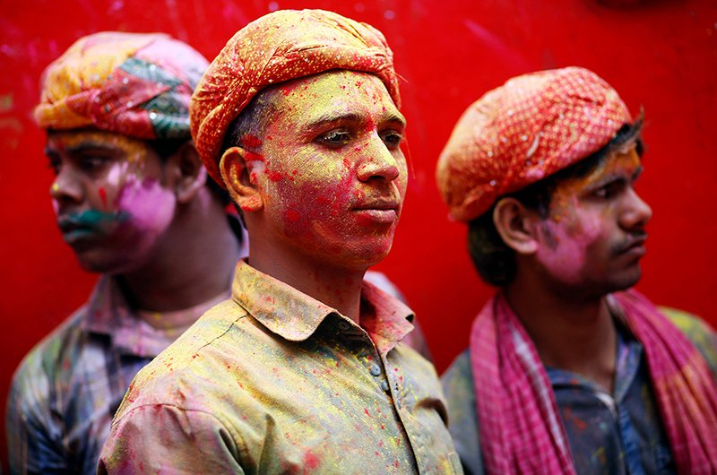 Hindu devotees wait to go inside the Bankey Bihari temple during Holi celebrations in Vrindavan, in the northern Indian state of Uttar Pradesh on March 1, 2015. Holi, also known as the Festival of Colors, heralds the beginning of spring and is celebrated all over India. Photo courtesy of REUTERS/Anindito Mukherjee