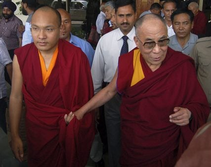 Karmapa Lama, left, and Tibet's exiled Buddhist spiritual leader the Dalai Lama arrive at the Kangra airport on the outskirts of the northern Indian hilltown of Dharamsala on May 16, 2011. Photo courtesy of REUTERS/Stringer  *Editors: This photo can only be republished with RNS-KARMAPA-HARVARD, originally transmitted on March 26, 2015.