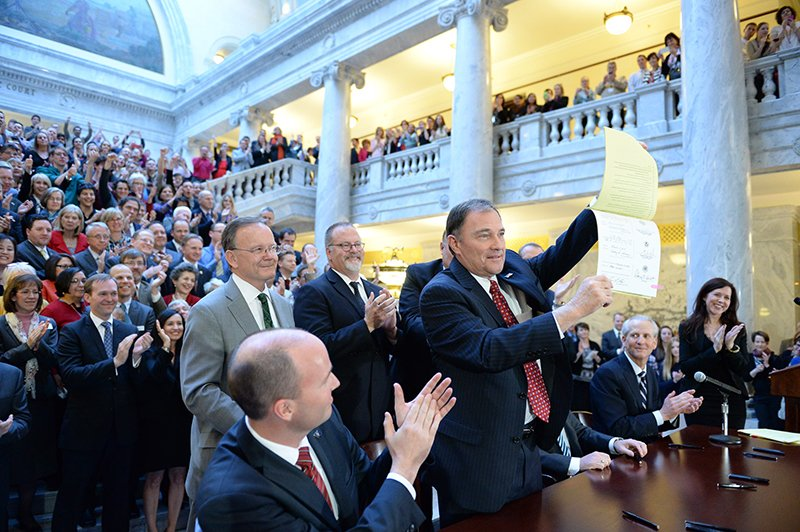 Utah Governor Gary Herbert displays Senate Bill 296 after signing it into state law. Photo courtesy the Church of Jesus Christ of Latter-Day Saints