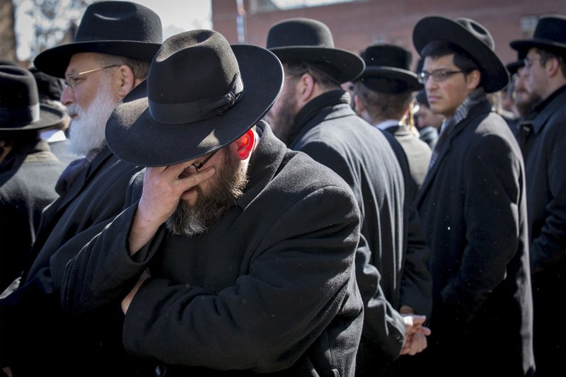 Mourners attend the funeral for seven children killed in a Brooklyn fire in New York on March 22, 2015. The funeral of seven Orthodox Jewish children who perished in one of New York's deadliest fires in years drew a sea of mourners on Sunday to a Brooklyn neighborhood where the blaze has raised concerns about the safety of Sabbath cooking practices. Photo courtesy of REUTERS/Brendan McDermid *Editors: This photo may only be republished with RNS-ORTHODOX-FIRE, originally transmitted on March 23, 2015.