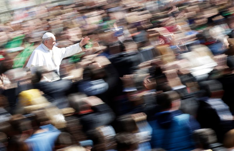 Pope Francis waves as he arrives to lead the general audience in St. Peter's Square at the Vatican on March 18, 2015.  Photo courtesy of REUTERS/Max Rossi *Editors: This photo may only be republished with RNS-POPE-TRANSGENDER, originally transmitted on March 19, 2015.