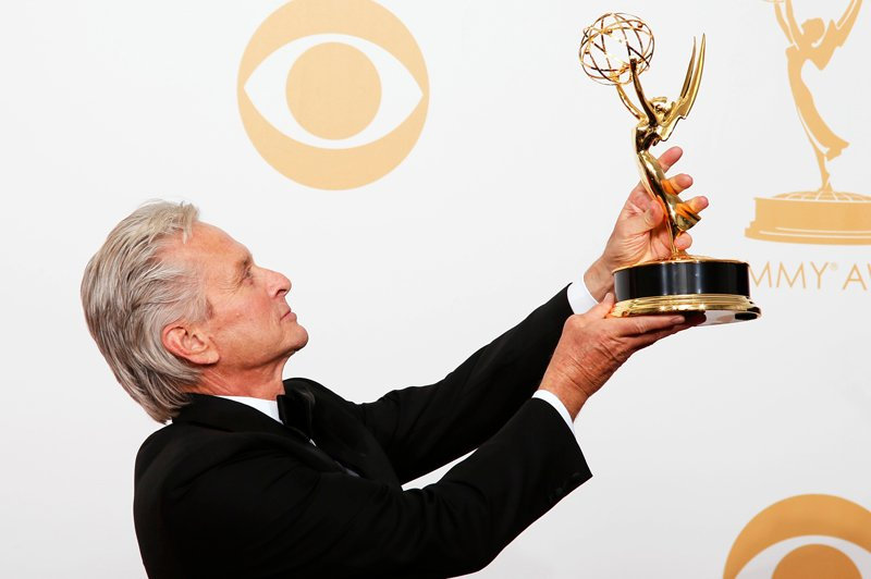 "Actor Michael Douglas from HBO's movie ""Behind the Candelabra"" poses backstage with his award for Outstanding Lead Actor In A Miniseries Or A Movie at the 65th Primetime Emmy Awards in Los Angeles on September 22, 2013. Photo courtesy of REUTERS/Lucy Nicholson  *Editors: This photo may only be republished with RNS-SALKIN-COLUMN, originally transmitted on March 18, 2015."