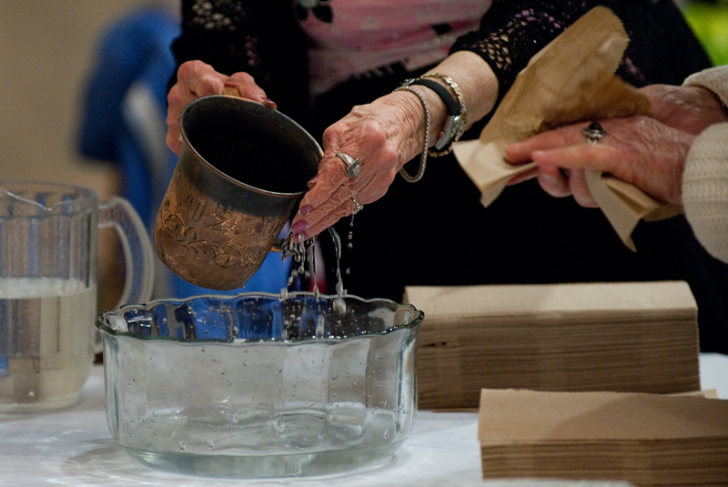 Women wash their hands as a ritual during the sisterhood/zhava annual women's seder at Congregation Beth El of Montgomery County in Bethesda, Md., on Sunday, March 22, 2015. Religion News Service photo by Sait Serkan Gurbuz