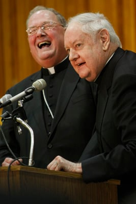 Milwaukee Archbishop Timothy M. Dolan, left, newly appointed as archbishop of New York, laughs as New York Cardinal Edward M. Egan responds to a reporter's question during a news conference at Cathedral High School in New York. Religion News Service photo by Gregory A. Shemitz