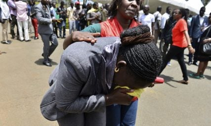 A Red Cross worker comforts a mourner as bodies of the students killed in a Thursday (April 2) attack, arrive at the Chiromo Mortuary in Nairobi. At least 147 people died in an assault by Somali militants on a Kenyan university, as anger grew among local residents over what they say was a government failure to prevent bloodshed.  REUTERS/Herman Kariuki