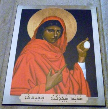 The story of Mary Magdalene offering Tiberius Caesar an egg may be the origin of the Easter egg. This painting was photographed inside Grace Cathedral in San Francisco, Calif. Religion News Service photo by Kimberly Winston