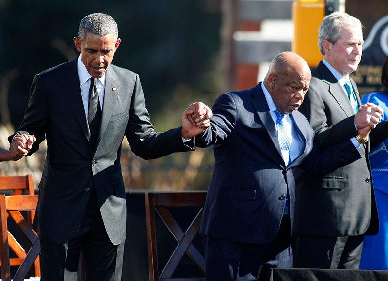 U.S. President Barack Obama (L), U.S. Congressman John Lewis (C) and former U.S. President George W. Bush hold hands during a prayer in Selma, Ala., on March 7, 2015. Obama delivered remarks at the Edmund Pettus Bridge to commemorate the 50th anniversary of the Selma to Montgomery civil rights marches. Photo courtesy of REUTERS/Tami Chappell *Editors: This photo may only be republished with RNS-BARBER-COLUMN, originally transmitted on April 9, 2015.