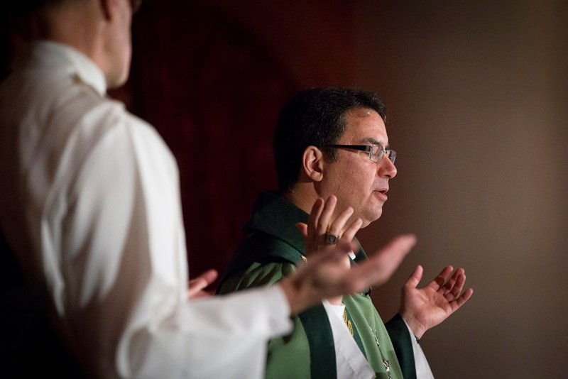 Bishop Oscar Cantu of Las Cruces, N.M., prays over the Eucharist during Mass on Feb. 9, 2015 at the Omni Shoreham Hotel in Washington. Bishop Cantu is chairman of the U.S. bishops' Committee on International Justice and Peace. Photo by Tyler Orsburn, courtesy of Catholic News Service