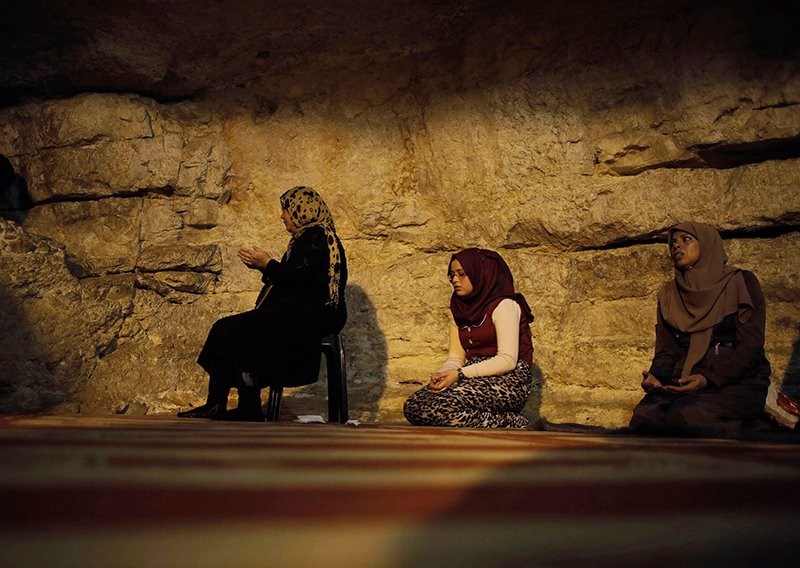 Palestinian women pray inside the Dome of the Rock at the compound known to Muslims as Noble Sanctuary and to Jews as Temple Mount during Friday prayers in Jerusalem's Old City on November 14, 2014. Photo courtesy of REUTERS/Ammar Awad *Editors: This photo may only be republished with RNS-DIG-MORIAH, originally transmitted on April 10, 2015.