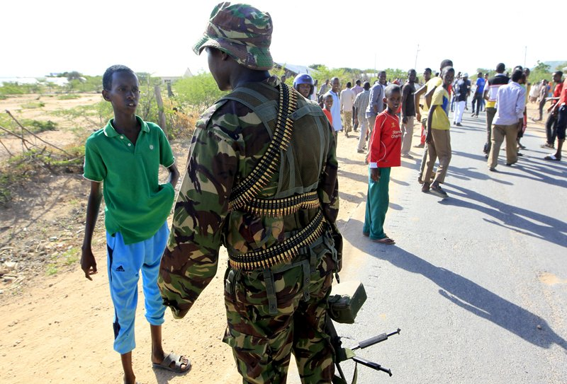 A Kenya Defense Force soldier stops a boy from moving in the direction where attackers are holding up at a campus in Garissa on Thursday (April 2, 2015). At least 14 people were killed on Thursday when Islamist militant group al Shabaab stormed the Kenyan university campus, taking Christians hostage and engaging security forces in a shootout for several hours. Photo courtesy of REUTERS/Noor Khamis *Editors: This photo may only be republished with RNS-KENYA-ATTACK, originally transmitted on April 2, 2015.