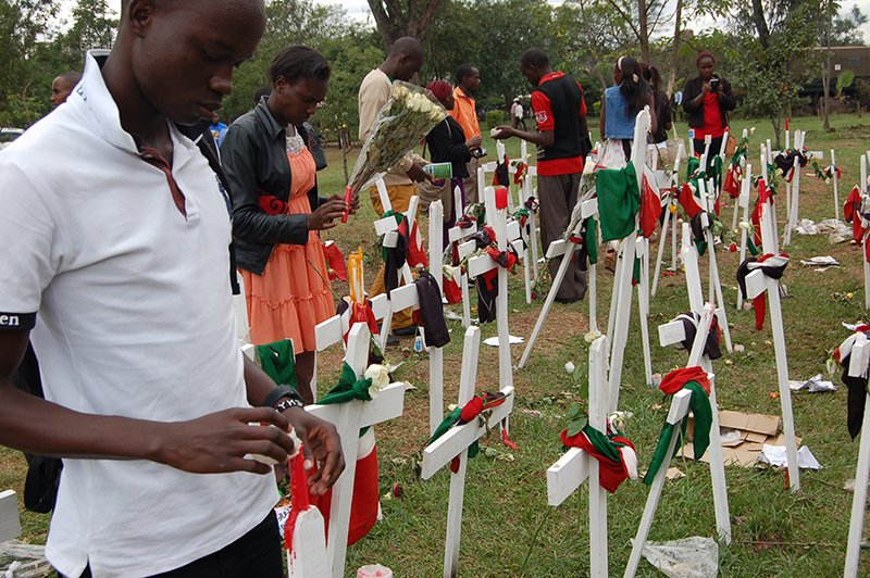 Youth light candles at Freedoms Corner to remember students killed by Al-Shabaab at Garissa University College. Religion News Service photo by Fredrick Nzwili
