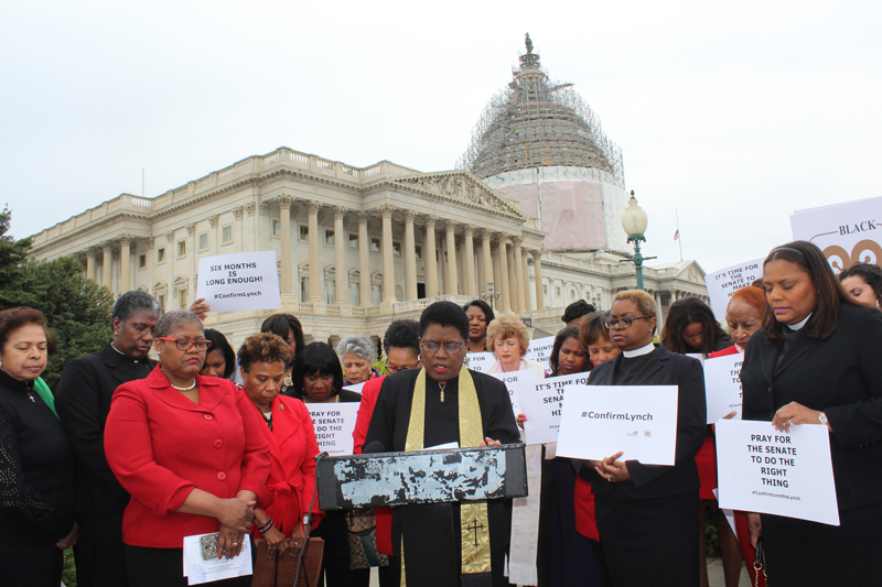 "The Rev. Barbara Williams-Skinner, co-chair of the National African-American Clergy Network, leads a ""pray-in"" on April 15, 2015 of women urging the Senate to confirm U.S. Attorney Loretta Lynch as the next attorney general. The Rev. Leah Daughtry, immediately to the right of Williams-Skinner, offered one of the prayers. Religion News Service photo by Adelle M. Banks"