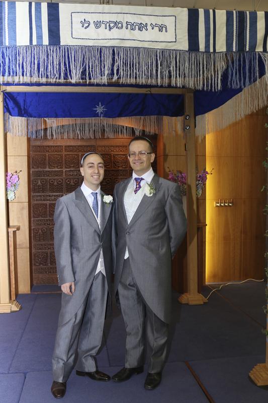 Eli Kaufman, left, with his husband Paul Ginsberg under the Chuppah during their wedding. Photo courtesy of Paul Ginsberg