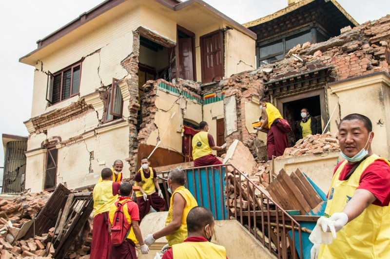 Buddhist monk volunteers remove and transport Buddhist scripture and relics to a safer place after an earthquake destroyed the Swayambhunath temple complex. Religion News Service photo by Vishal Arora
