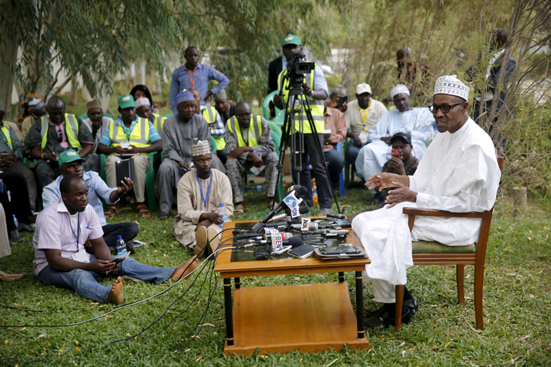 All Progressives Congresses presidential candidate and Nigeria's former military ruler Muhammodu Buhari addresses a news conference outside his house after he voted in Daura, on March 28, 2015. Photo courtesy of REUTERS/Akintunde Akinleye *Editors: This photo may only be republished with RNS-NIGERIA-BUHARI, originally transmitted on April 1, 2015.