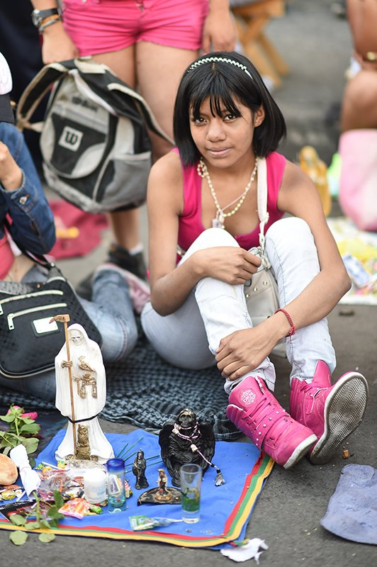 A teenage devotee at Santa Muerte Rosary service in Tepito, Mexico City, on August 1, 2014. Photo courtesy of Toni Francois