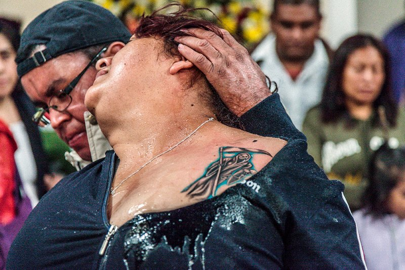 Blessing of fire - a devotee has her tattoo sanctified' - Pachuca, Hidalgo State, 2013. Photo courtesy of Angus Fraser