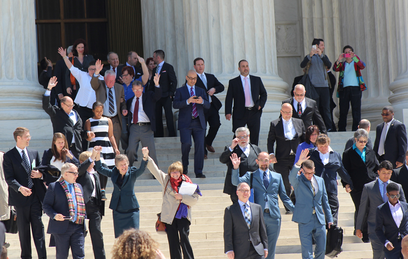 People, including plaintiffs, leave the arguments of the Supreme Court on April 28, 2015 when the justices considered whether to legalize same-sex marriage nationwide. Religion News Service photo by Adelle M. Banks