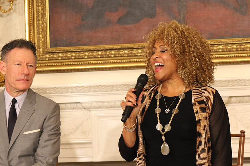 """Singer Darlene Love sings """"His Eye Is On the Sparrow"""" at the conclusion of a workshop about gospel music at the White House on April 14, 2015. To her left is singer-songwriter Lyle Lovett. Religion News Service photo by Adelle M. Banks"""
