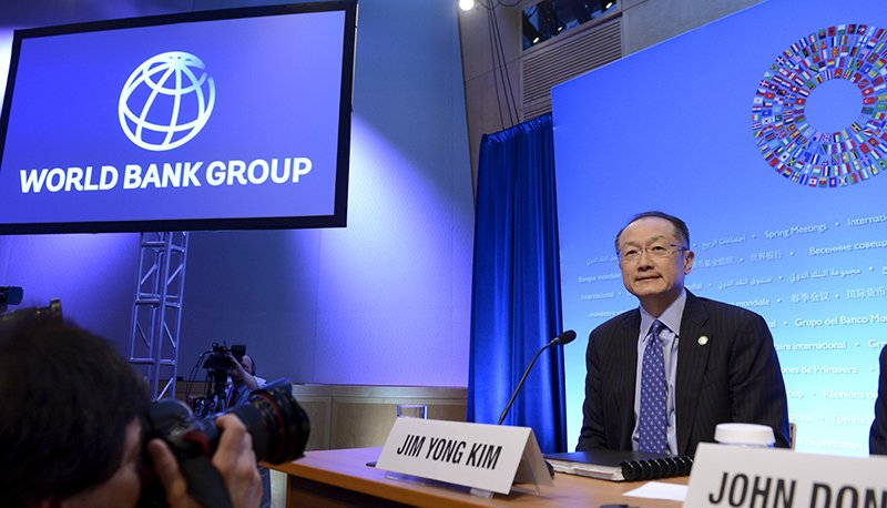 World Bank President Jim Yong Kim takes his seat as he arrives to brief the press at the opening of the IMF and World Bank's 2015 Annual Spring Meetings, in Washington, on April 16, 2015. Photo courtesy of REUTERS/Mike Theiler  *Editors: This photo may only be republished with RNS-WORLDBANK-POOR, transmitted on April 22, 2015.
